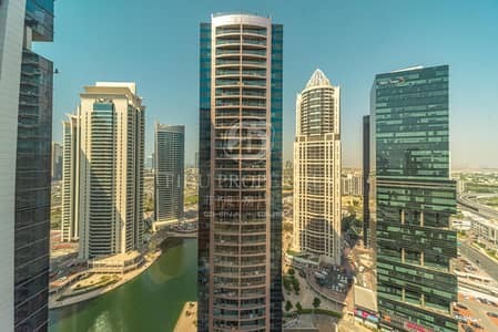 Office for Rent in Jumeirah Lake Towers (JLT), Dubai - Full Floor | Fitted and Partitioned | 9 Parkings