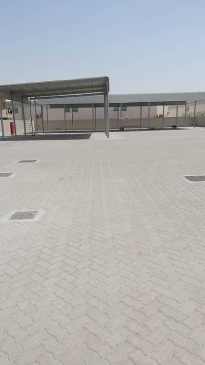 Industrial Land for Rent in Emirates Industrial City, Sharjah - Baundry wall +  open shed for rent in emirates industrial city al hanoo sajaa