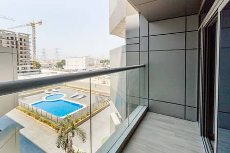 Studio for Rent in Jumeirah Village Circle (JVC), Dubai - 2 MONTHS FREE!! 550 Sq. Ft. Studio with Equipped Kitchen |  Balcony with Pool View + Amazing Amenities | JVC