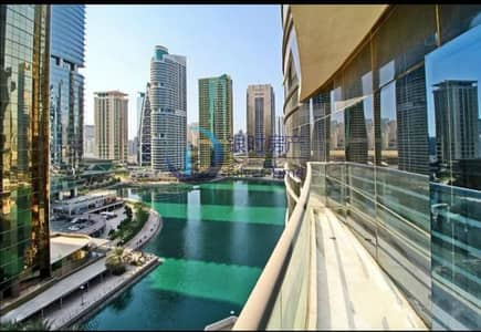 شقة 1 غرفة نوم للبيع في أبراج بحيرات الجميرا، دبي - Stunning Full Lake View | Rented | Fully Furnished