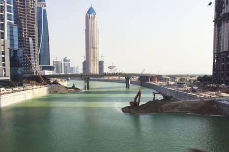 ارض استخدام متعدد  للبيع في الخليج التجاري، دبي - New Plot directly on the Canal l best location