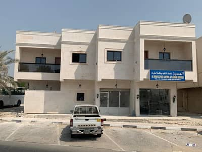 Building for Sale in Ajman Downtown, Ajman - Building for sale, ground and first residential, commercial, masterpiece site on Sinnara roundabout in Naimiya,