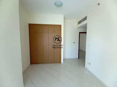فلیٹ 1 غرفة نوم للايجار في مدينة دبي الرياضية، دبي - nice view  no separate chiller  1 bedroom with huge L type  balcony close kitchen full lake view