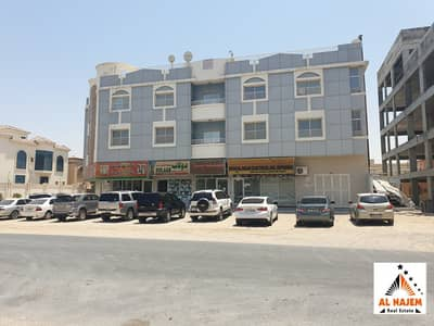 Building for Sale in Al Rawda, Ajman - The sale is a residential and commercial building on the corner street in Al Rawda 2 area in Ajman