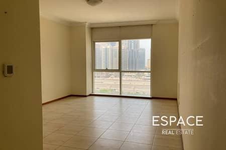 فلیٹ 1 غرفة نوم للايجار في أبراج بحيرات الجميرا، دبي - Near Metro Station | Unfurnished | Vacant | Low Floor