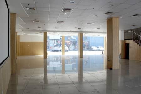 Showroom for Rent in Deira, Dubai - Huge Showroom  Facing al Etihad Main Road  Near DNATA high visibility