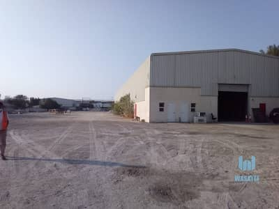 Plot for Rent in Al Quoz, Dubai - HUGE PLOT WITH A LARGE WAREHOUSE FOR RENT /10AED PER SQFT. .