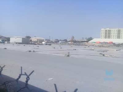 ارض صناعية  للبيع في القوز، دبي - PRIVATE COMMERCIAL PLOT FOR SALE IN AL-QUOZ WITH A  FULL FENCE&WAREHOUSE. .