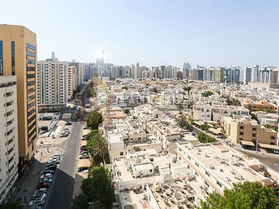 2 Bedroom Apartment for Rent in Airport Street, Abu Dhabi - For Rent I Community View I 2 BR w/ Balcony