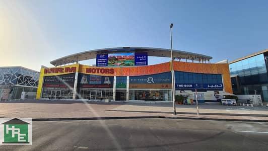 معرض تجاري  للايجار في أم الشيف، دبي - Fitted Showroom   Sheikh Zayed Road Facing