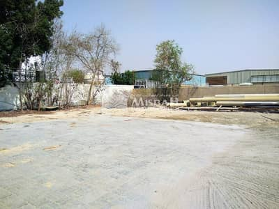 Industrial Land for Rent in Jebel Ali, Dubai - OPEN LAND FOR COMMERCIAL/ STORAGE USE- WITH WAREHOUSE