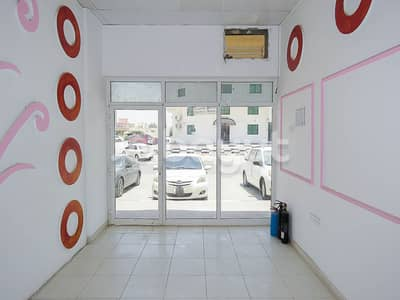 Shop for Rent in Al Rawda, Ajman - SHOP 13000 FOR RENT 2 MONTH FREE NO COMM. DIRECT FROM OWNER   NEAR SHEIKH AMMAR STREET ABBAYA ROUNDABOUT