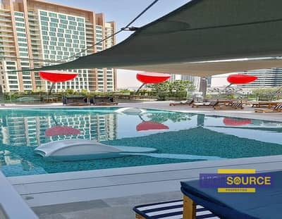 استوديو  للايجار في الخليج التجاري، دبي - Full Facility Building Studio Apartment with Balcony for Rent in MAG 318 Business Bay   Only AED 50k