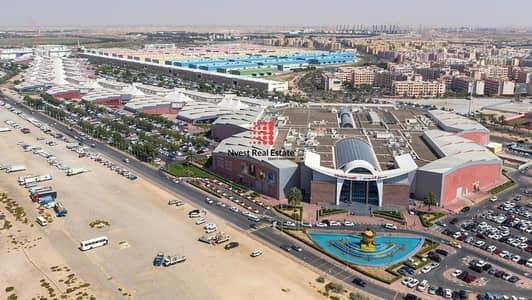 مستودع  للبيع في المدينة العالمية، دبي - Freehold Warehouse Land/17500 Built Up Area/Next to Dubai Textile City/Al Warsan