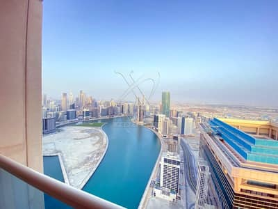 4 Bedroom Apartment for Rent in Business Bay, Dubai - High Floor with Canal View   Vacant   3BR + Maid's Room