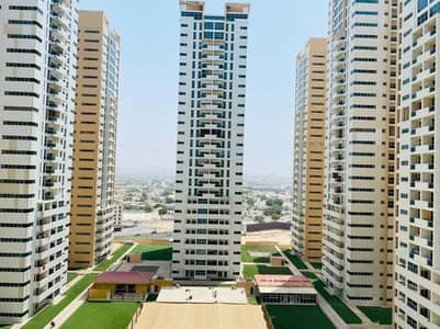 2 bhk closed kitchen garden view with parking for rent in Ajman one tower