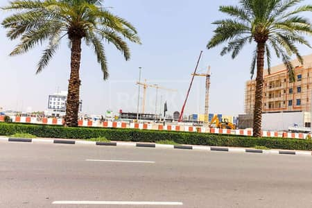 ارض تجارية  للبيع في المدينة العالمية، دبي - Corner Plot | Shopping Mall | G+2 - Prime Location