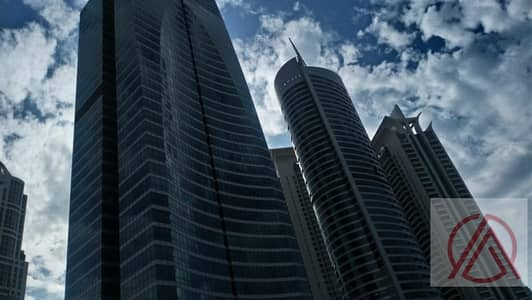 Office for Rent in Jumeirah Lake Towers (JLT), Dubai - Fitted office in X3 Middle Floor for 39k