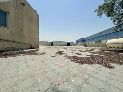 Industrial Land for Rent in Al Quoz, Dubai - Open yard with Warehouse for rent in Al quoz
