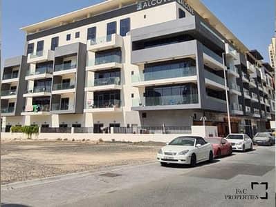 فلیٹ 1 غرفة نوم للايجار في قرية جميرا الدائرية، دبي - Corner l Chiller free l Poolview| Fitted Kitchen