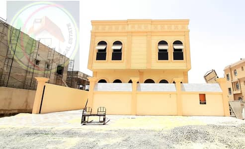 6 Bedroom Villa for Sale in Al Helio, Ajman - The villa, the first inhabitant of double glass, has European designs, the best decorations and architectural decorations, a large extension in front