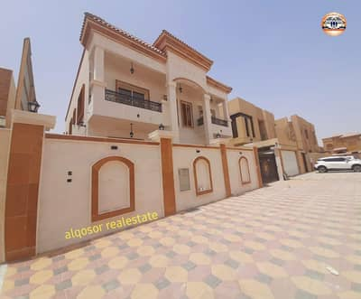 5 Bedroom Villa for Sale in Al Mowaihat, Ajman - For sale villa in Ajman, Al Mowaihat area, Arabic design, facing stone, freehold ownership for all nationalities without down payment