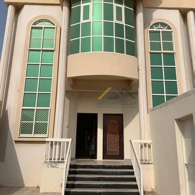 Very clean villa for rent in Al Rawda 2, an area of 5000 sq. ft. with split air conditioners