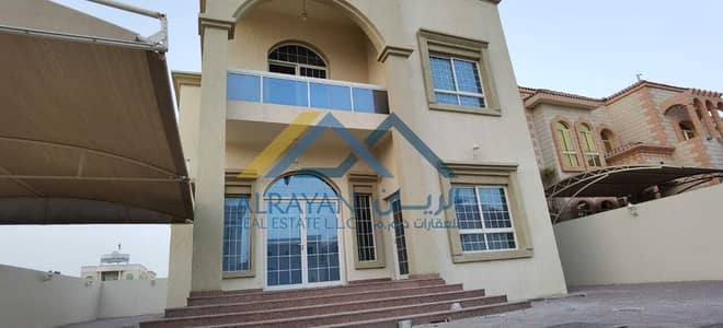 New villa for rent in Al Rawda 2, an area of 6000 feet, near Sheikh Ammar Street, with split air conditioning