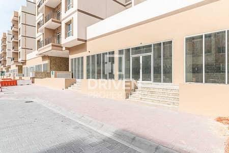 محل تجاري  للايجار في قرية جميرا الدائرية، دبي - Shell and Core Retail Space in May Residence