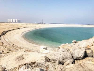 ارض سكنية  للبيع في جزيرة المرجان، رأس الخيمة - Residential Land - G plus 4 - Close to the Beach