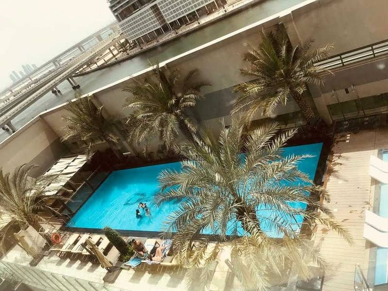 12 Elegant Fully Furnished Unit   1BR    Pool View   Ready to move in