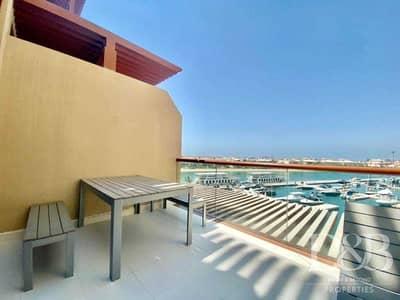 استوديو  للايجار في نخلة جميرا، دبي - Studio | Unfurnished | Burj & Sea Views