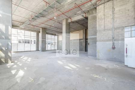 محل تجاري  للايجار في داون تاون جبل علي، دبي - Shell and core retail space on low floor