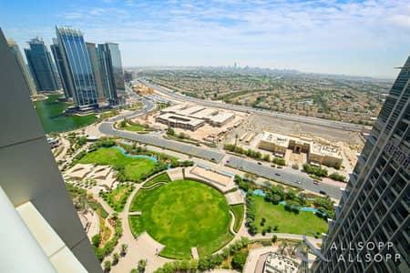 فلیٹ 1 غرفة نوم للايجار في أبراج بحيرات الجميرا، دبي - 1-Bed   Chiller Free   Meadow Balcony View