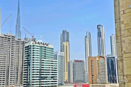 استوديو  للبيع في الخليج التجاري، دبي - Burj Khalifa/Canal View   Studio Apartment