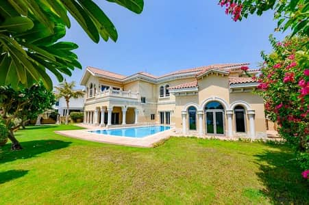 6 Bedroom Villa for Sale in Palm Jumeirah, Dubai - Central Pool Layout |High Number |Ready to move in