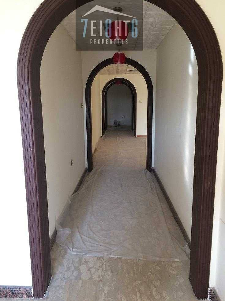 3 b/r semi-independent ground floor villa + maids room + private garden + large sharing s/pool for rent in Umm Al Sheif