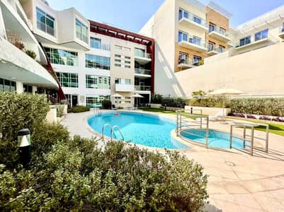 2 Bedroom Apartment for Rent in Jumeirah Village Circle (JVC), Dubai - PAY 4CHQS | LAVISH 2BR LIVING | PRIVATE GARDEN | GROUND FLOOR UNIT @55K