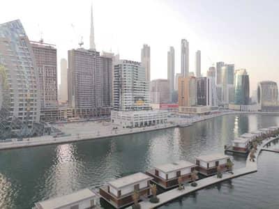 شقة 1 غرفة نوم للايجار في الخليج التجاري، دبي - شقة في برج سكالا الخليج التجاري 1 غرف 65000 درهم - 5179426