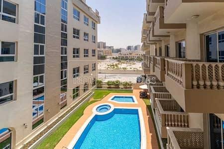 استوديو  للايجار في قرية جميرا الدائرية، دبي - Stunning Pool View | Furnished | Vacant