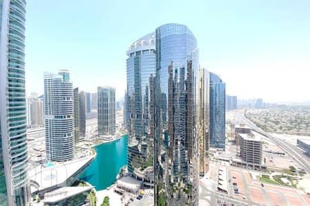 شقة 2 غرفة نوم للايجار في أبراج بحيرات الجميرا، دبي - Exclusive | High Floor | Fully Furnished