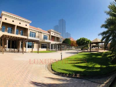 4 Bedroom Villa for Rent in Al Towayya, Al Ain - Shared Entrance Pool Gymnasium Private Backyard