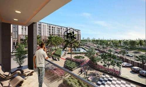 فلیٹ 2 غرفة نوم للبيع في دبي لاند، دبي - شقة في برج روكان ركان دبي لاند 2 غرف 600000 درهم - 5014913