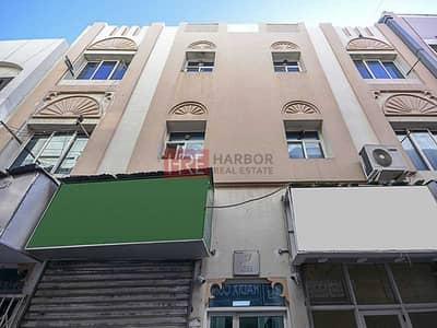 Studio for Rent in Bur Dubai, Dubai - Open Kitchen   Awqaf Building   Family Building