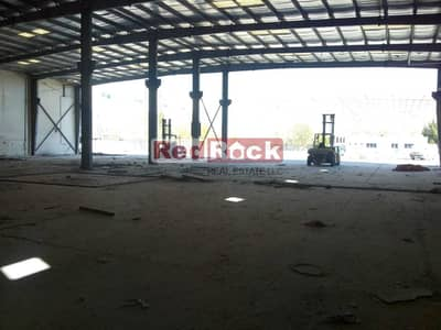 Warehouse for Sale in Dubai Investment Park (DIP), Dubai - Independent Open Land With 700Kw Electric Load For Sale In DIP