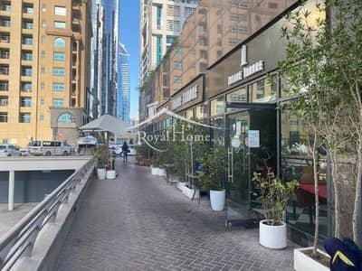محل تجاري  للايجار في أبراج بحيرات الجميرا، دبي - Shop in JLT perfect for restaurant