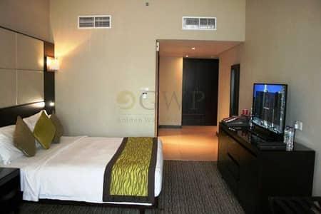 شقة فندقية  للبيع في أبراج بحيرات الجميرا، دبي - Furnished Studio apt I Spacious layout I SZR View