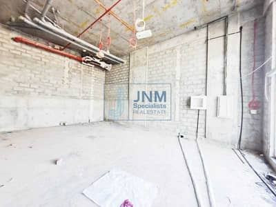 Shop for Rent in Arjan, Dubai - Shell and Core Retail Shop | Front Facing