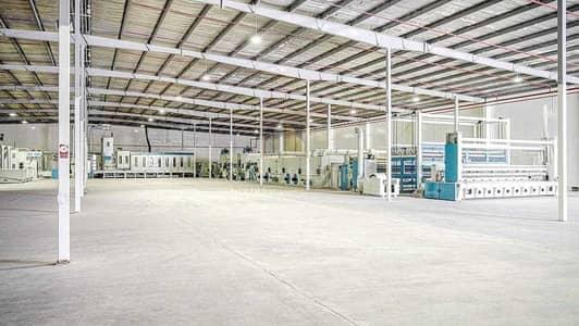 مستودع  للبيع في منطقة سیف (المنطقة الحرة بمطار الشارقة)، الشارقة - Warehouse with Manufacturing Factory for Needle Punched