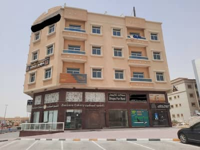 Building for Sale in Al Hamidiyah, Ajman - For sale residential commercial building Al-Hamidiyah corner of two streets, new